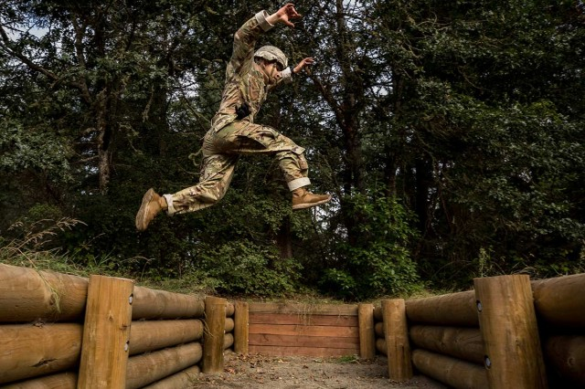 A Soldier leaps over an obstacle during the Army Best Medic Competition at Joint Base Lewis-McChord, Wash., Sept. 24, 2019. Twenty-eight two-Soldier teams from all around the world traveled to Washington state to compete in the finals to be named the Army's Best Medic. The competition is a 72-hour arduous test of the teams' physical and mental skills.