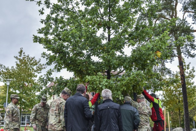U.S. Soldiers from 7th Army Training Command (7 ATC) and community members plant an oak tree outside of the 7th ATC headquarters, Tower Barracks, Grafenwhoehr, Germany Oct. 8, 2019. The Oak tree is the national tree for both Germany and the United States and stands for the symbiotic relationship between the local and military communities.(U.S. Army photo by Sgt. Christopher Stewart)