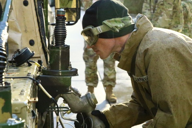 A Soldier with the 240th Composite Supply Company, 18th Combat Sustainment Brigade, refuels the 1st Cavalry Division convoy, Oct. 16, 2019, Magdeburg, Germany. The 1st Cavalry Division Soldiers are driving from Vlissingen, Netherlands, across Germany to Poland where they will work in support of Operation Atlantic Resolve for the next nine months. (U.S. Army photo by Spc. Joseph Knoch)