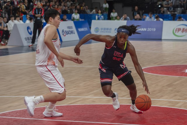 U.S. Army Sgt. Donita Adams, U.S. Armed Forces women's basketball player, drives past a Chinese defender during the Conseil International du Sport Militaire Women's Basketball Competition in Wuhan, China, Oct. 22, 2019. The 7th CISM Military World Games will feature military athletes from around the world with an estimated participation of more than 100 nations and more than 10,000 participants.