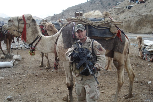 U.S. Army Master Sgt. Matthew Williams assigned to 3rd Special Forces Group (Airborne), stands outside of a local market place in Eastern Afghanistan, December 2007.