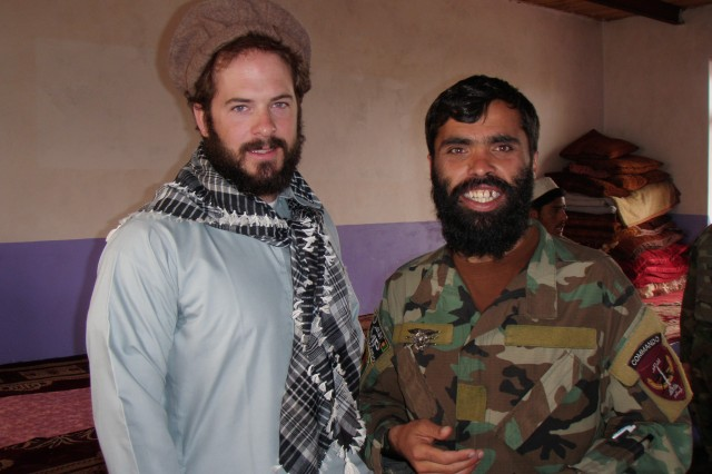 Then-Sgt. Matthew Williams assigned to 3rd Special Forces Group (Airborne), stands with an Afghanistan commando sergeant major, after conducting a local meeting with the key leader of a village outside of Camp Morehead, Afghanistan in 2011.