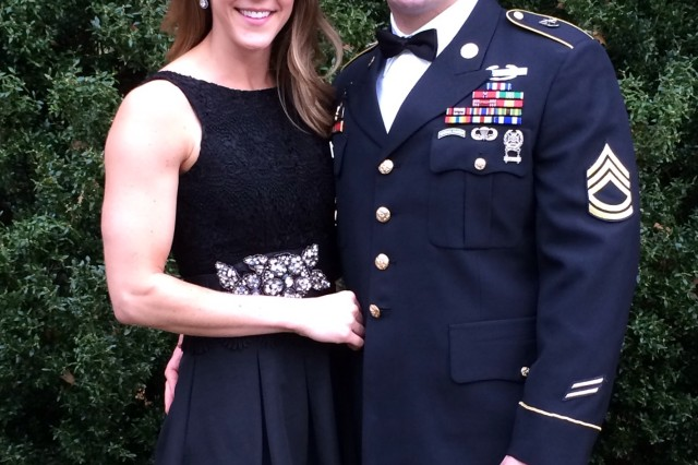 U.S. Army Master Sgt. Matthew Williams assigned to 3rd Special Forces Group (Airborne), poses with his wife just before they attend a friends wedding ceremony in October 2013.