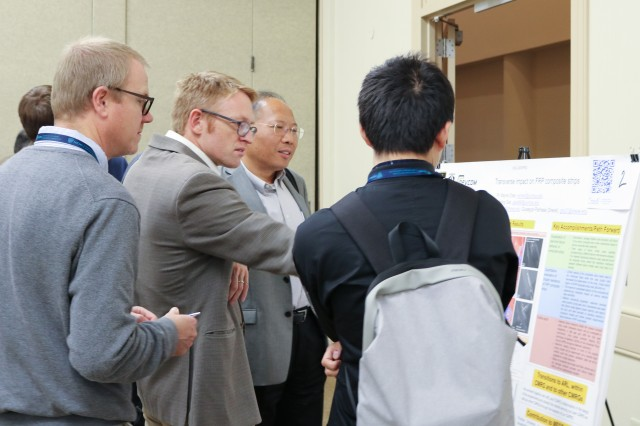 Dr. Danny O'Brien, CCDC Army Research Laboratory co-lead for the MEDE composites group, reviews a poster during the technical poster session at the fall meeting, Oct. 17 in Towson, Maryland.