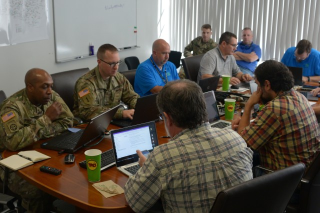 Information Management (G6) Cyber Technician Leads Chief Warrant Officer 3 Dion Griffith (far left), Chief Warrant Officer 2 Michael Spivey (beside Griffith) and Cyber Technician 2nd Lt. Micheal Youngbar (far right) work with Stanly, Albemarle, Henderson, Ashe, Rowan, Wake Forest, Greenville, and Onslow city and county cyber strike teams at Joint Force Headquarters in Raleigh, N.C., Oct. 4, 2019. The North Carolina Local Government Information System Association consists of information technology professionals and the North Carolina National Guard, who work together as a strike team to help each other when disasters or issues occur.