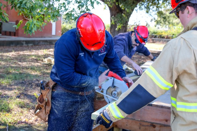 FORT BENNING, Ga. -- Members of the Georgia Search and Rescue performed rescue training Oct. 23 at Ragin Court here, where the Fort Benning Directorate of Emergency Services had partially collapsed a former residential building. (U.S. Army photo by Markeith Horace, Maneuver Center of Excellence and Fort Benning Public Affairs)