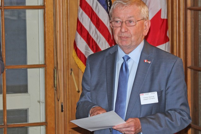 """Canadian Consul to the United States in Detroit, Joseph Comartin, addresses his guests at a reception before the screening of """"As If They Were Angels"""" at the Grosse Pointe War Memorial in Michigan Oct. 22. (Photo by Scott Wakefield)"""