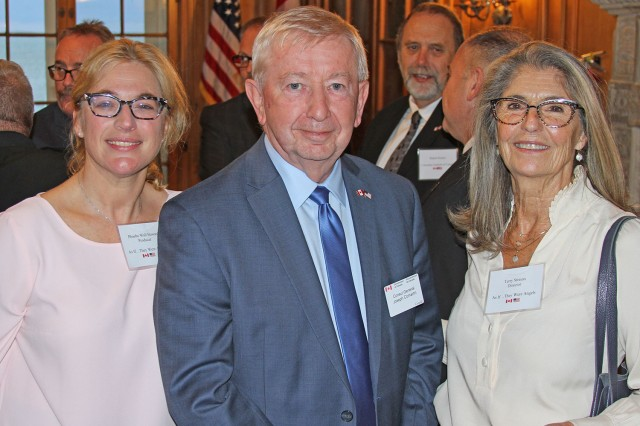 """Canadian Consul to the United States in Detroit, Joseph Comartin (center) poses with the producer of """"As If They Were Angels"""", Phoebe Wall Howard (left) and director, Terry Strauss (right), at the Grosse Pointe War Memorial in Michigan Oct. 22. (Photo by Scott Wakefield)"""