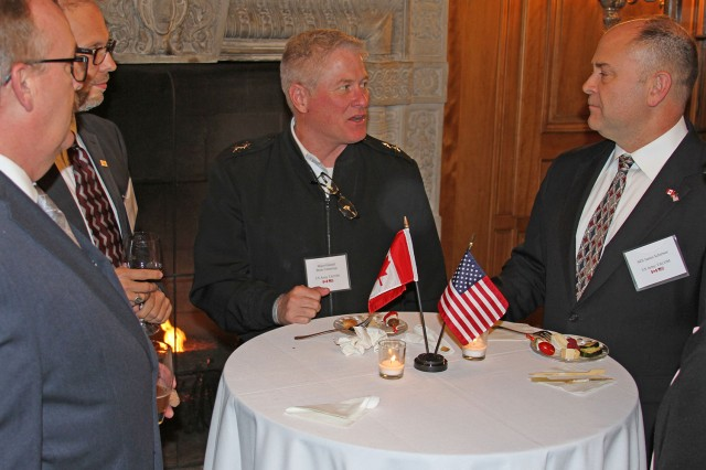 """Maj. Gen. Brian Cummings, Program Executive Office Ground Combat Systems (center), chats with other guests of the Consul General of Canada at a reception before the screening of """"As If They Were Angels"""" at the Grosse Pointe War Memorial on Oct. 22. (Photo by Scott Wakefield)"""