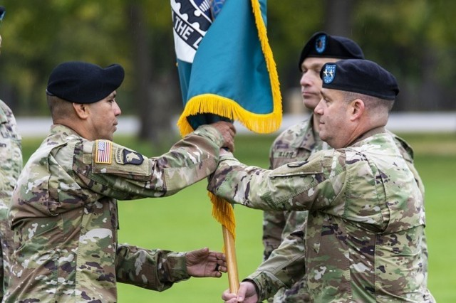 Command Sgt. Maj. Marco Torres receives the ASC colors from Maj. Gen. Steven Shapiro, commanding general of the U.S. Army Sustainment Command, during a change of responsibility ceremony held Oct. 22 on Memorial Field at Rock Island Arsenal.  (Photo by Linda Lambiotte, ASC Public Affairs)