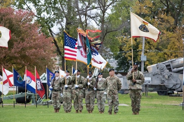 The ASC color guard stands at attention on a windswept day during a change of responsibility ceremony held Oct. 22 on Memorial Field at Rock Island Arsenal.  (Photo by Debralee Best, RIA-JMTC)