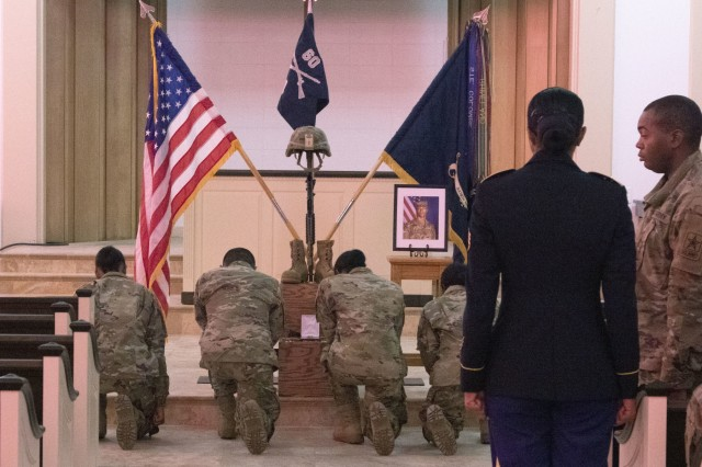 Soldiers of Company A, 3rd Battalion, 60th Infantry Regiment, take a knee to say a short prayer or bid a final farewell to Pvt. Andrew Dante McLean on Oct. 18 at the Daniel Circle Chapel. McLean was only with his unit for 33 days when he passed away preparing for physical training.