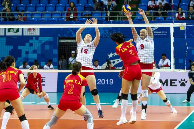 Kylie Churches (15) and Abbey Hall (9) block a shot during the U.S. Armed Forces Women's volleyball team match against China in the first preliminary round of the CISM 2019 Military World Games in Wuhan, China, Oct. 16, 2019.
