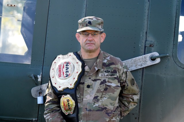 Lt. Col. Pete Caragher, Deputy G-3, 85th U.S. Army Support Command, pauses for a photo with his first place belt in the expert category from the 2012 New England Championships in Springfield, Massachusetts. Caragher, is an award-winning Brazilian Jiu-Jitsu competitor. Originally from Schiller Park, Illinois, Caragher became interested in Jiu-Jitsu during his second tour as an Active Guard/Reserve officer based in California. He practices Jiu-Jitsu three or four times a week and currently holds a brown belt in the sport. His sports background includes participation in wrestling, hockey, football, cross training and the triathlon. Caragher joined the Army in 1985 and graduated from the Reserve Officer Training Corp at Northern Illinois University. He was awarded the Meritorious Service Medal for his service on a combat tour in Iraq from May 2006 until August 2007. (U.S. Army Reserve photo by Capt. Michael Ariola)
