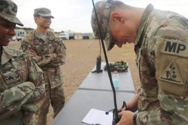 A military police competitor checks communication equipment during 2019's Military Police Competitive Challenge at Fort Leonard Wood, Mo.