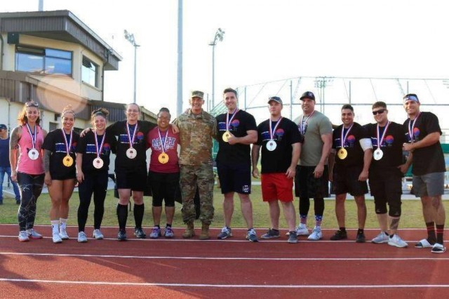 Gina Petrino (far left), a U.S. Army Corps of Engineers, Far East District contract specialist, after she won 2nd place for her weight class at  the 2019 U.S. Army Garrison Humphreys Strongest Warrior competition, at Balboni Field, Camp Humphreys, South Korea, Oct. 19. (U.S. Army photos by Pfc. Kaden D. Pitt and Pfc. Jillian Hix, 20th Public Affairs Detachment)