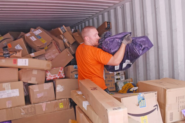 John Lunkenheimer unloads the mail truck.
