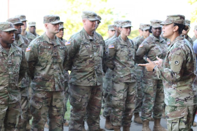 1st Sgt. Tammy A. Belcher, first sergeant, Headquarters and Headquarters Company, 1st Theater Sustainment Command (TSC) commends 1st TSC Soldiers outside the unit's barracks following a walk-through conducted by Sgt. Major of the Army Micheal A. Grinston Oct. 24, 2019, at Fort Knox, Ky. (U.S. Army photo by Sgt. Nahjier Williams)