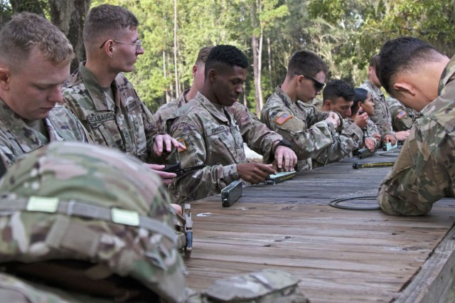 Soldiers assigned to the 92nd Engineer Battalion, 3rd Infantry Division, prepare composition C-4 explosives for a confidence charge during a demolition range training event, Oct. 17, 2019, at Fort Stewart, Georgia. The confidence charge helps combat engineers shake off any pre-training jitters and prepares newly assigned combat engineers to conduct the training confidently. (U.S. Army photo by Sgt. Arjenis Nunez)