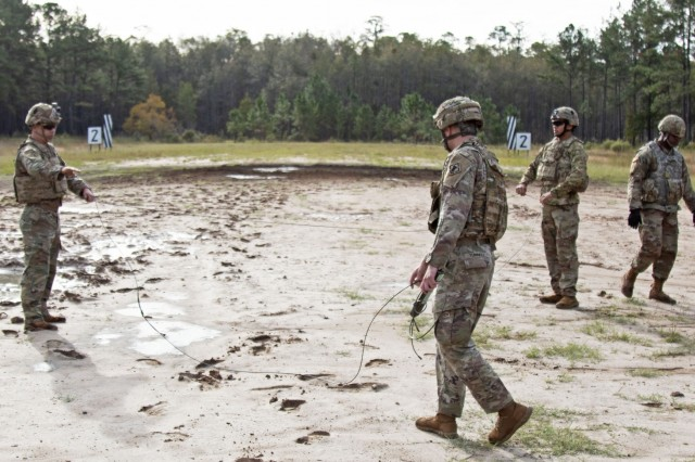Soldiers assigned to the 92nd Engineer Battalion, 3rd Infantry Division, prepare detonation cord for them to tie-in their composition C-4 explosives for a confidence charge during a demolition range training event, Oct. 17, 2019, at Fort Stewart, Georgia. This demolition range consisted of five different events: the confidence charge, timber cutting, urban breaching, cratering, and steel cutting and also included different types of explosives. (U.S. Army photo by Sgt. Arjenis Nunez)