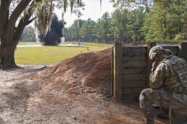 Soldiers assigned to 92nd Engineer Battalion, 3rd Infantry Division, detonate a confidence charge during a demolition range training event, Oct. 17, 2019, at Fort Stewart, Georgia. This demolition range consisted of five different events: the confidence charge, timber cutting, urban breaching, cratering, and steel cutting, and also included different types of explosives. (U.S. Army photo by Sgt. Arjenis Nunez)
