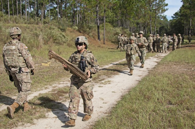 Soldiers assigned to 92nd Engineer Battalion, 3rd Infantry Division, clear out wood chunks after detonating composition C-4 explosives attached to a log during the timber cutting portion of a demolition range training event, Oct. 17, 2019, at Fort Stewart, Georgia. Training events such as this make combat engineers more effective in three main areas: mobility, counter mobility and survivability - enhancing the warfighter commitment to victory. (U.S. Army photo by Sgt. Arjenis Nunez)