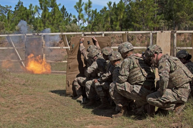 Soldiers assigned to 92nd Engineer Battalion, 3rd Infantry Division, stand behind a blast blanket while detonating a breaching charge during the urban breaching portion of a demolition range training event, Oct. 17, 2019, at Fort Stewart, Georgia. Training events such as this make combat engineers more effective in three main areas: mobility, counter mobility and survivability - enhancing the warfighter commitment to victory. (U.S. Army photo by Sgt. Arjenis Nunez)