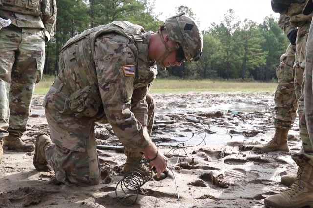 Sgt. Joseph Rice, a combat engineer assigned to 530th Clearance Company, 92nd Engineer Battalion, 3rd Infantry Division, prepares a confidence charge at the Engineer Qualification Area on Fort Stewart, Ga., Oct. 17, 2019. The demo range was designed to enhance three main focus areas: mobility, countermobility and survivability in austere environments. (U.S. Army photo by Sgt. Zoe Garbarino/Released)
