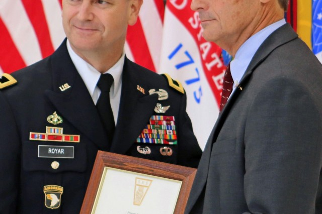 Maj. Gen. Todd Royar, commanding general of the of the U.S. Army Aviation and Missile Command, presents a Certificate of Senior Executive Service to Geoff Downer, director of the AMCOM's Special Programs (Aviation), during a SES appointment ceremony Oct. 18 at Joint Base Langley-Eustis, Virginia. (Photo by Gina Baltrusch, AMCOM Public Affairs)
