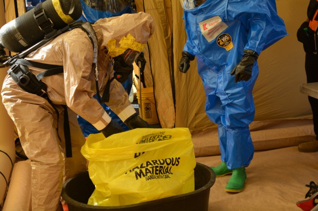 Army Staff Sgt. Matthew Kauffman works to decontaminate items during the Pennsylvania National Guard's 3rd Weapons of Mass Destruction Civil Support Team evaluation exercise Oct. 25 at Steam Town National Historic Park, Scranton, Pa.