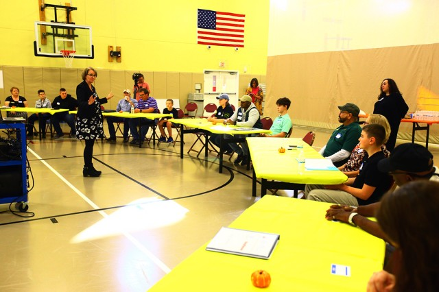 Susan Ciavolino, Boys and Girls Clubs of America director of youth development programs, welcomes children and adults to the STEM design charrette Oct. 23, 2019, at the Fort Sill Youth Center.