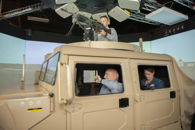 Leadership Kansas members immerse themselves in a simulator at the Close Combat Tactical Trainer at Fort Riley, Kansas, on October 23. The members had a chance to fire upon virtual targets while driving through a computer-generated environment that replicates one of the live-fire ranges on post. (U.S. Army photos by Spc. Joshua Oh, 19th Public Affairs Detachment)