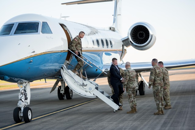 Secretary of the Army Ryan McCarthy (center) shakes hands with Maj. Gen. John Evans Jr. as Sgt. Maj. of the Army Michael Grinston disembarks from their aircraft after arriving at Fort Knox Oct. 23, 2019. Grinston and McCarthy spent three days meeting several leaders and Soldiers before traveling back to Pentagon.