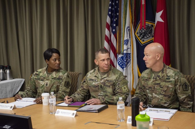Sgt. Maj. of the Army Michael Grinston (cemter) speaks with HRC's command team, Command Sgt. Maj. Lynice Thorpe-Noel (left) and Maj. Gen. Joseph Calloway (right), during his three-day visit to Fort Knox.