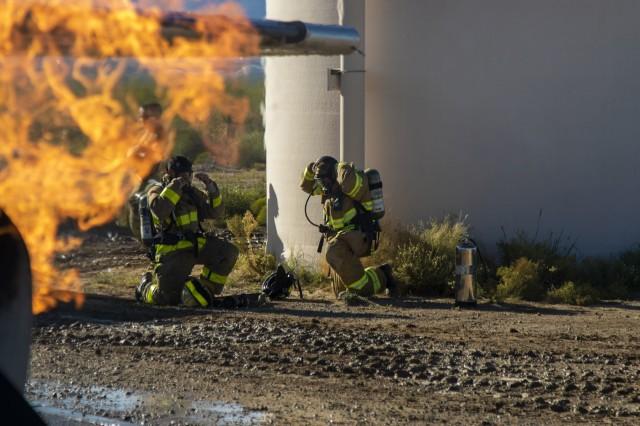 Firefighters assigned to 463rd Engineer Firefighter Detachment, U.S. Army Reserve don their protective equipment before engaging a fixed-wing aircraft fire during pre-deployment training at White Sands Missile Range, N.M., Oct. 21, 2019.  Elements of 463rd came together from Houston, Texas and Sturtevant, Wis. to prepare for an upcoming deployment to the middle-east. (U.S. Army photo by Staff Sgt. Timothy Gray, 5th Armored Brigade)