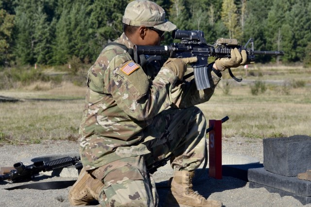 "Cpl. Leron Vicente of 1st Battalion, 17th Infantry Regiment, 2nd Stryker Brigade, 2nd Infantry Division takes aim with his M4 Carbine at a qualification range on Joint Base Lewis McChord, Wash., Oct. 2, 2019. In addition to becoming an expert on multiple weapons, Vicente is excited to earn his Expert Infantry Badge to ""show others that I know how to do my job!"""