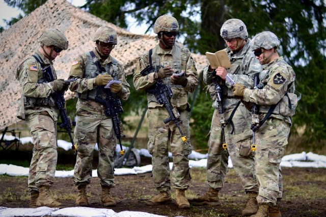 """Sgt. Kevin Evans, 1st Squad Leader, Battle Company, 1-17 Infantry Battalion, reviews emergency medical performance measures with his Soldiers during Expert Infantry Badge and Expert Soldier Badge Training at Joint Base Lewis McChord, Wash., Oct 17, 2019. """"On the battlefield, you never know who will get hit, so I need all of my Soldiers to be experts at these tasks,"""" said Evans. """"My life could be the one that they save""""."""