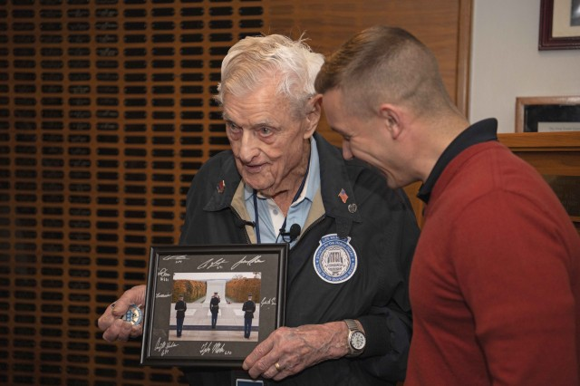 Army Capt. Harold Earls, right, commander of the Tomb Guard, presents World War II veteran Jack Eaton, 100, with a signed photo and challenge coin from the Tomb Guard. The presentation capped Eaton's visit to the Tomb of the Unknown Soldier at Arlington National Cemetery in Arlington, Va., Oct, 23, 2019. Eaton, a former Army corporal, served as a sentinel at the Tomb of the Unknown Soldier from 1938-1940.