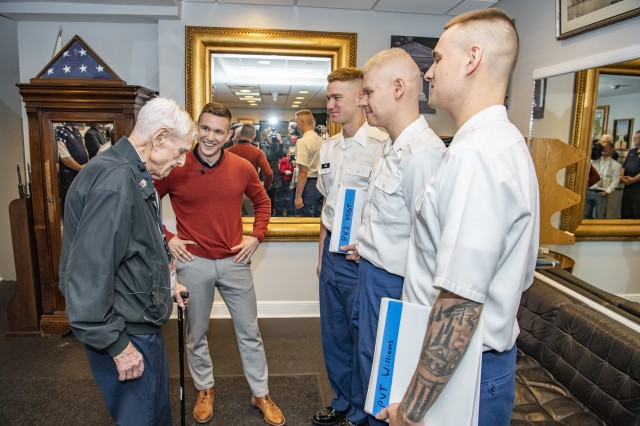 World War II veteran Jack Eaton, left, and Army Capt. Harold Earls, commander of the Tomb Guard, speak to new recruits in the Tomb Quarters at Arlington National Cemetery, Va., Oct. 23, 2019. Eaton, a former Army corporal, served as a sentinel at the Tomb of the Unknown Soldier from 1938-1940.