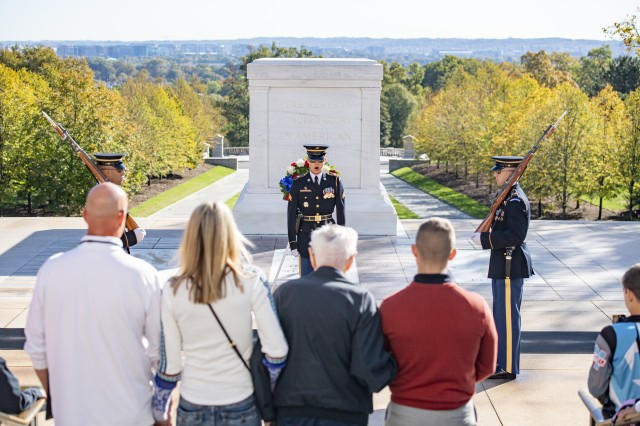 World War II veteran Jack Eaton, his family and Army Capt. Harold Earls, commander of the Tomb Guard, watch the Changing of the Guard Ceremony at the Tomb of the Unknown Soldier at Arlington National Cemetery, Va., Oct. 23, 2019. Eaton, a former Army corporal, served as a sentinel at the Tomb of the Unknown Soldier from 1938-1940.