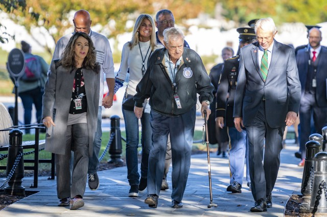 Karen Durham-Aguilera, executive director, Arlington National Cemetery and Army National Military Cemeteries, World War II veteran Jack Eaton, 100, and Rep. Jack Bergman of Michigan walk at Arlington National Cemetery, Va., Oct. 23, 2019. Eaton, a former Army corporal, served as a sentinel at the Tomb of the Unknown Soldier from 1938-1940.