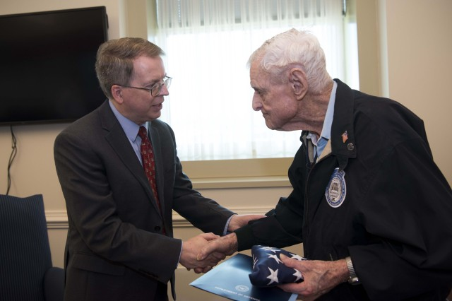 Deputy Defense Secretary David L. Norquist shakes hands with World War II veteran Jack Eaton, 100, at the Pentagon, Oct. 23, 2019. Eaton, a former Army corporal, served as a sentinel at the Tomb of the Unknown Soldier from 1938-1940.