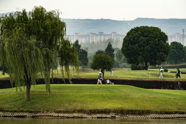 A member of the U.S. armed forces men's golf team walks between holes during a men's golf tournament at the 2019 CISM Military World Games in Wuhan, China, Oct. 23, 2019. The U.S. team earned a bronze medal.