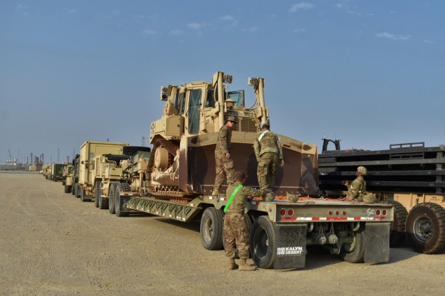 U.S. Soldiers in the 30th Armored Brigade Combat Team, assist in the line-up and preparation of vehicles for movement to their base in Kuwait after being off-loaded from ships at Shuaiba Port, Kuwait, Oct. 21-25, 2019.  The unit is mobilized to support Operation Spartan Shield and is comprised of units from the North Carolina, South Carolina, Ohio and West Virginia Army National Guard. (U.S. Army National Guard photo by Lt. Col. Cindi King)
