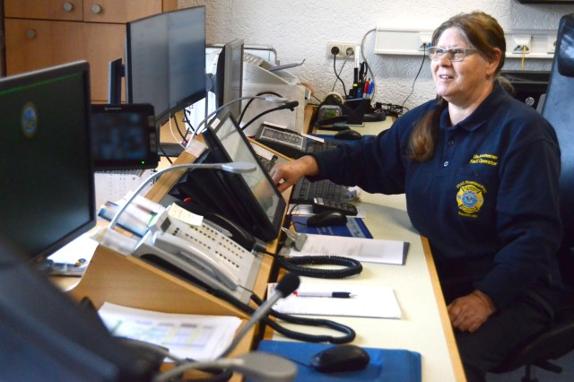 Ute Sponheimer, Baumholder Military Community emergency dispatcher, scans her screens for fire alarms during her shift recently.