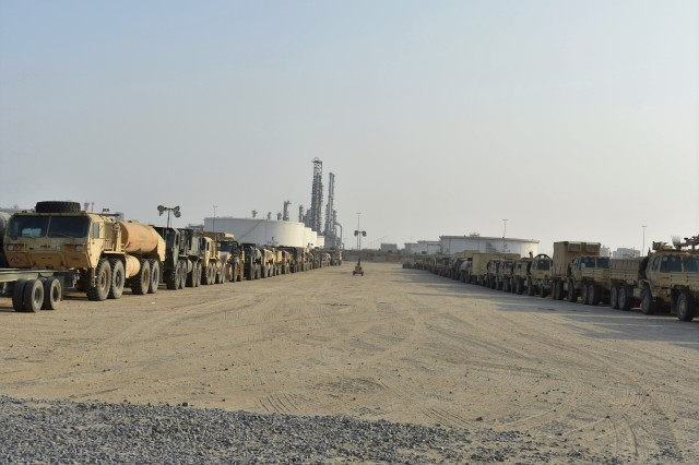 U.S. Soldiers in the 30th Armored Brigade Combat Team assist in the line-up and preparation of vehicles for movement to their base in Kuwait after being off-loaded from ships at Shuaiba Port, Kuwait, Oct. 21-25, 2019. The unit is mobilized to support Operation Spartan Shield and is comprised of units from the North Carolina, South Carolina, Ohio and West Virginia Army National Guard.