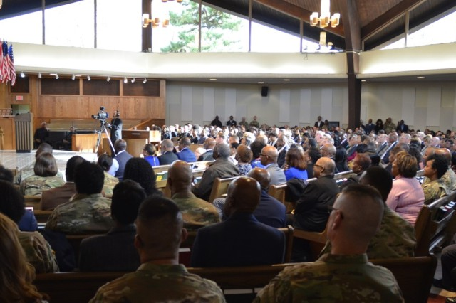 """During an emotional ceremony that featured a large family, a lifetime of mentors and teachers, and about 500 friends, R. Scott Dingle, The Army Surgeon General, was promoted to lieutenant general on Oct. 17, 2019, at the Fort Myer Memorial Chapel, Joint Base Myer-Henderson Hall.  """"Scott has extraordinary talents, and that's why we picked him,"""" said James C. McConville, who hosted.  """"His career has been full of great achievements.  He has had some of the hardest and most diverse assignments as an AMEDD officer.  He's commanded at every single level.  He is one of the best and brightest we have in the Army.  He is the right officer at the right time to be the Surgeon General."""