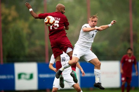 Army 1st Lt. Alexander Clark , right, of the U.S. Armed Forces Men's Soccer Team competes for the ball during a preliminary round match with Qatar for the Council of International Sports 2019 Military World Games in Wuhan, China Oct. 16, 2019. The CISM games open, Oct. 18, 2019 and close, Oct. 28, 2019.