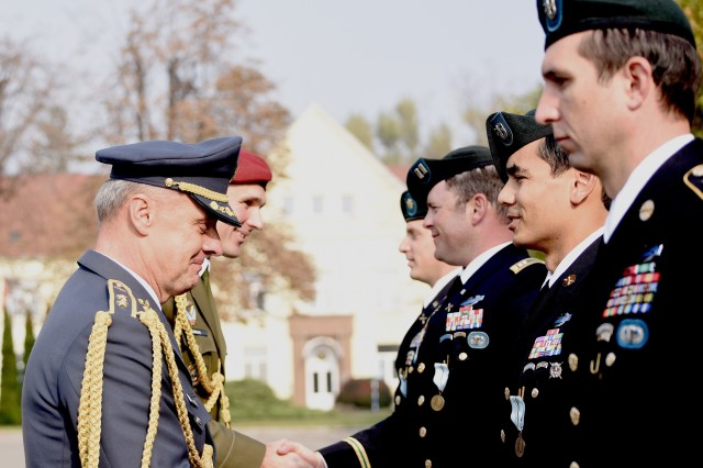 Czech Republic Air Force Maj. Gen. Jiri Verner presents the Medal of the Minister of Defense of Czech Republic to Texas Guardsmen assigned to the Army's 19th Special Forces Group (Airborne), during a ceremony in Prostejov, Oct. 25, 2019, hosted by their state partner, Czech Republic. The unique decoration was for supporting the Czech Allies during combat deployment to Afghanistan as part of Operation Resolute Support.