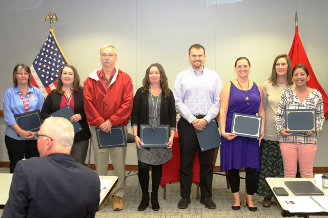 Kansas City District Contracting Division personnel were presented with a certificate of recognition by leadership for helping set up Contracting Fall Training October 22, 2019. Left to right - Jeri Halterman, Heather Scott, John Hendrix, Stephanie Kretzer, Zach Goodman, Sarah Moppin, Cheryl Colbert and Jo McCue.